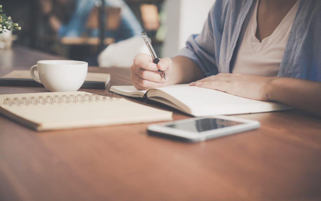 Women writing in a journal